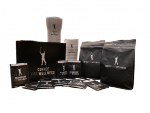 contents of deluxe phil mickelson coffee for wellness package with two white tumblers, two bags of coffee, and packets of the good stuff supplement
